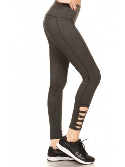 Solid Sport Leggings Tights With Banded High Waist, Cut Out Detail With Crossed Straps, And Overlock Stitching.