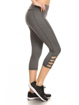 Solid, Cropped, Workout Pants In Fitted Style With Banded Elastic Waist, And Bottom Side Cutouts.